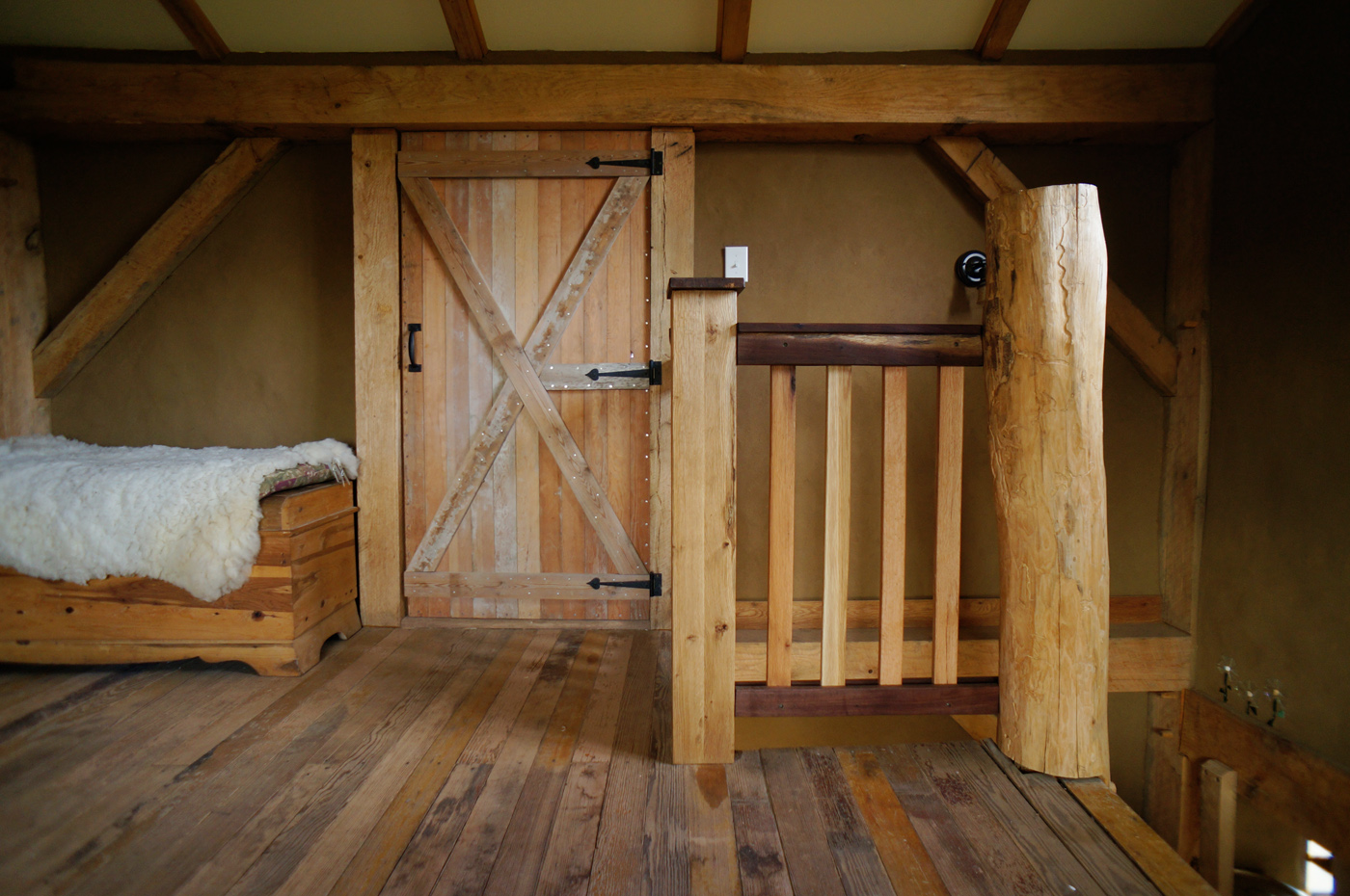 Building a diy wooden interior stair railing the year of mud for Diy timber frame plans
