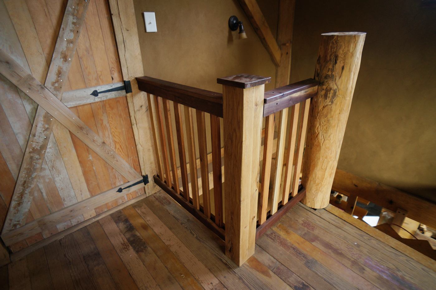 Building a diy wooden interior stair railing the year of mud for Wooden handrails for stairs interior