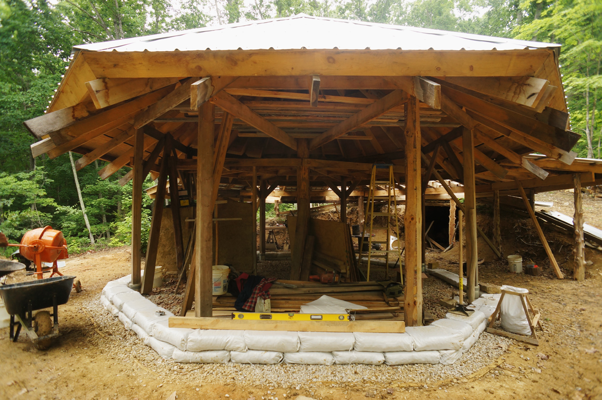 Why we 39 re building an earthbag stemwall the year of mud for Off grid cabin foundation