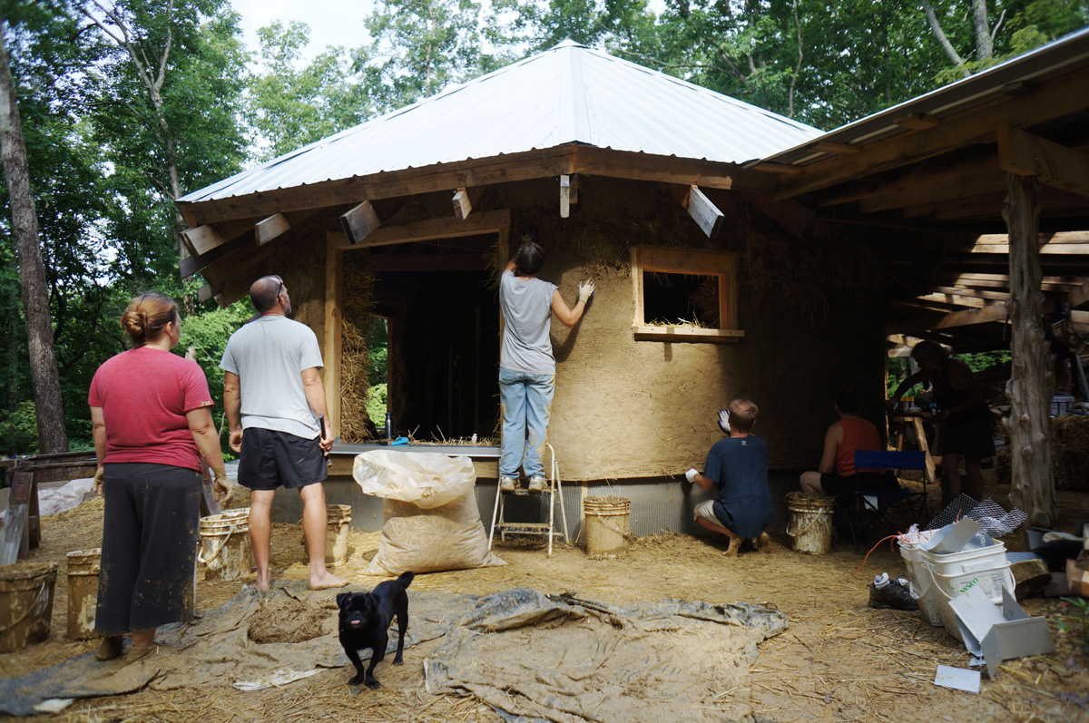 Off grid straw bale cabin photo gallery the year of mud for Off grid cabin foundation